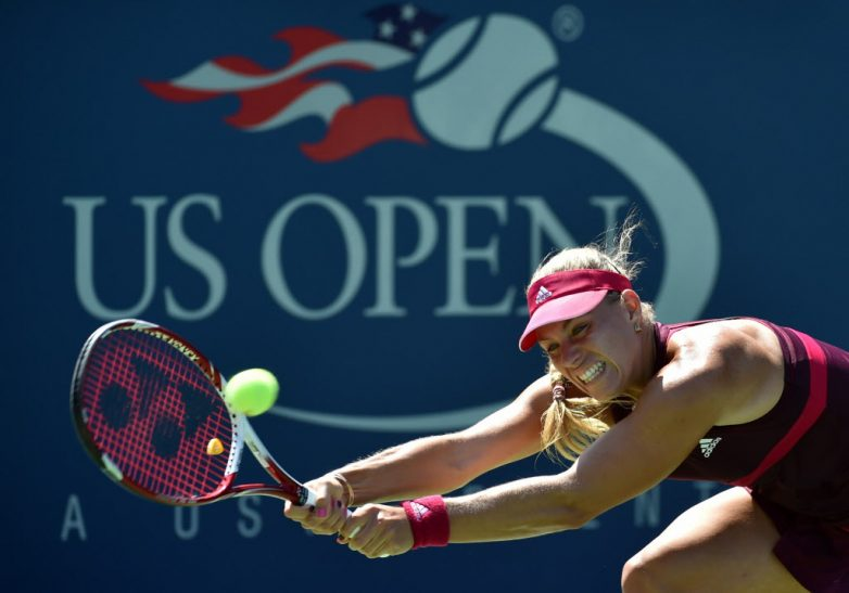 Angelique Kerber of Germany returns a shot to Ksenia Pervak of Russia during their 2014 US Open women's singles match at the USTA Billie Jean King National Tennis Center August 25, 2014 in New York. AFP PHOTO/Stan HONDASTAN HONDA/AFP/Getty Images ORG XMIT: 507840207